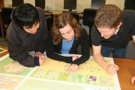 Students inspecting a plotted GIS map.
