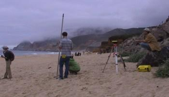 surveying on a beach